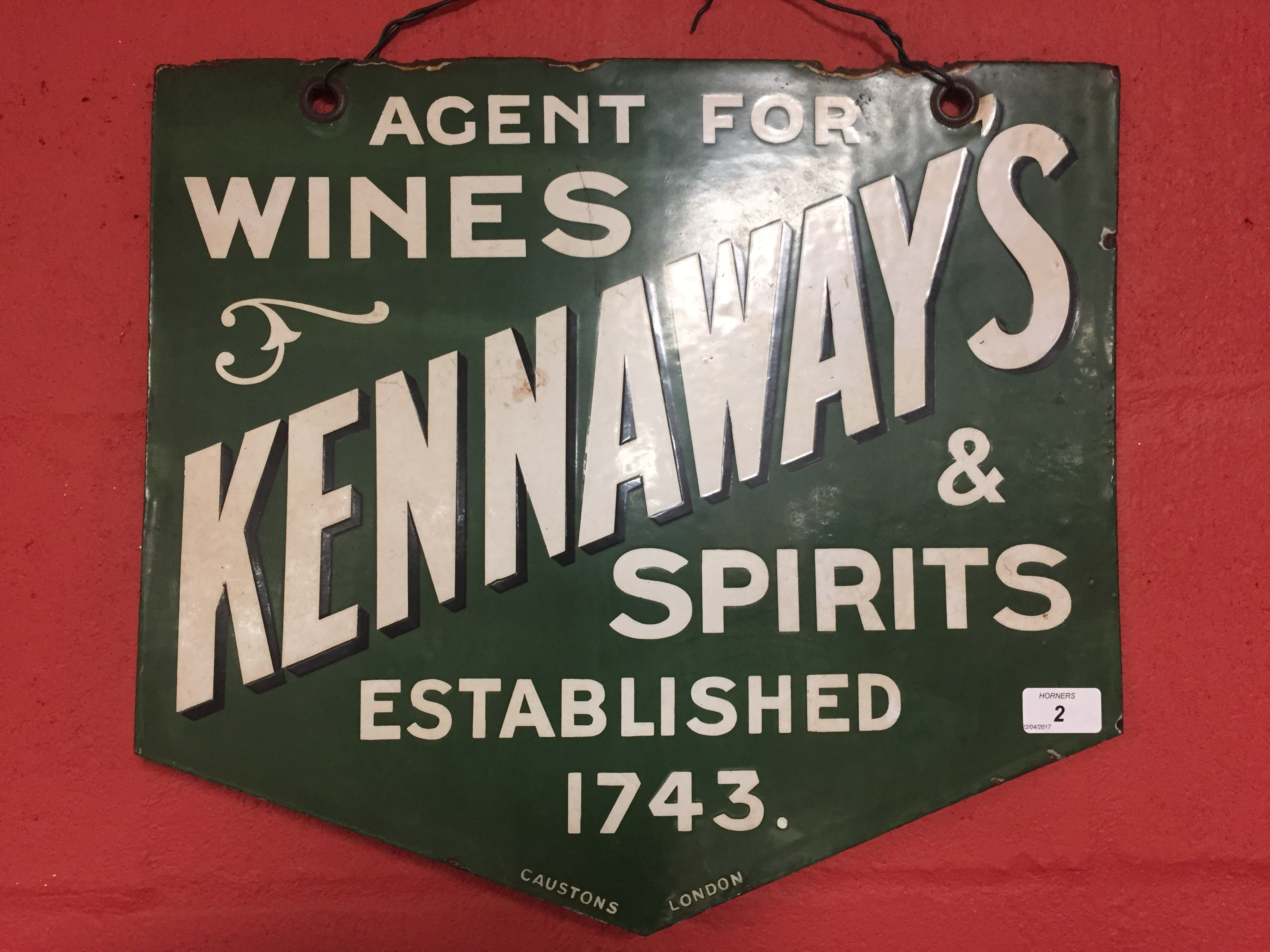 "Lot 2 - ENAMEL ADVERTISING SIGN ""KENNAWAYS WINES AND SPIRITS"""