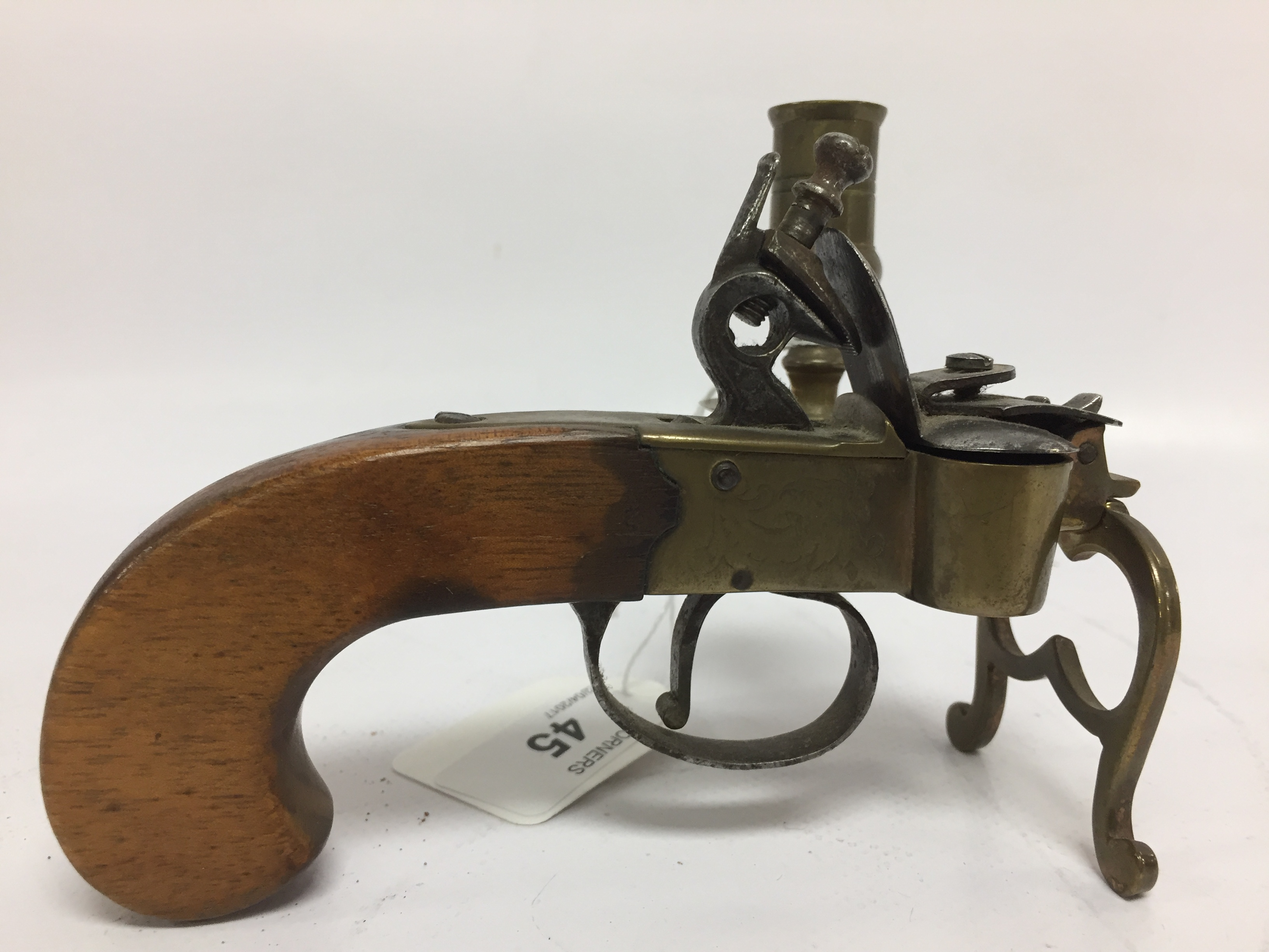 Lot 44 - AN ANTIQUE FLINTLOCK PISTOL TINDER LIGHTER