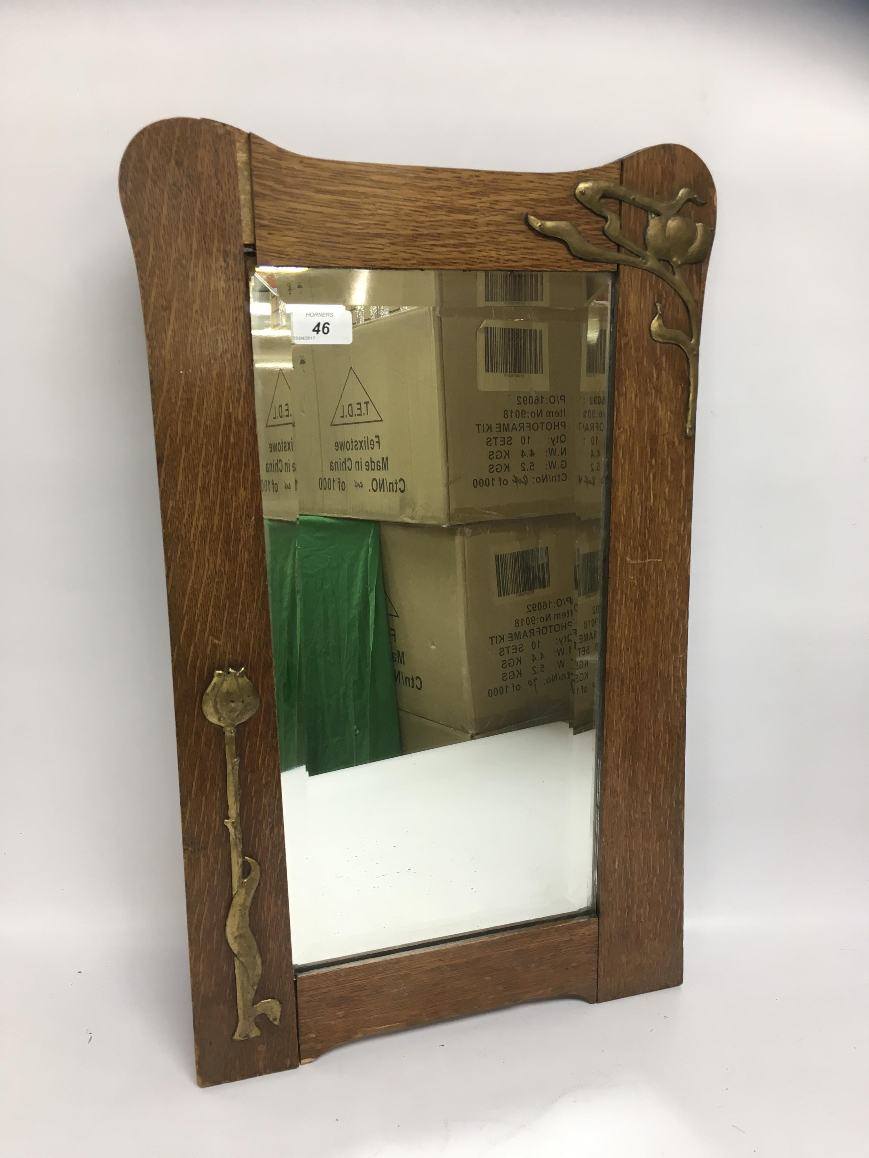 Lot 46 - OAK FRAMED ARTS AND CRAFTS MIRROR WITH APPLIED COPPER TULIPS,