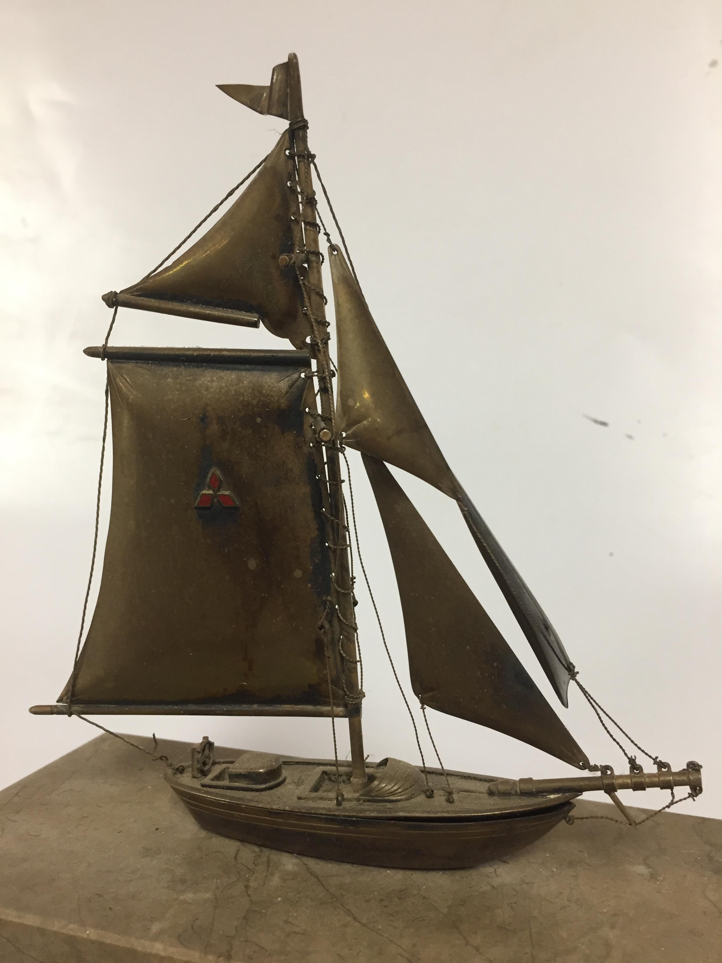 Lot 10 - WHITE METAL MODEL OF SAILING BOAT ON MARBLE AND WOODEN PLINTH BEARING LABEL OKOHAMA SHIPYARD AND