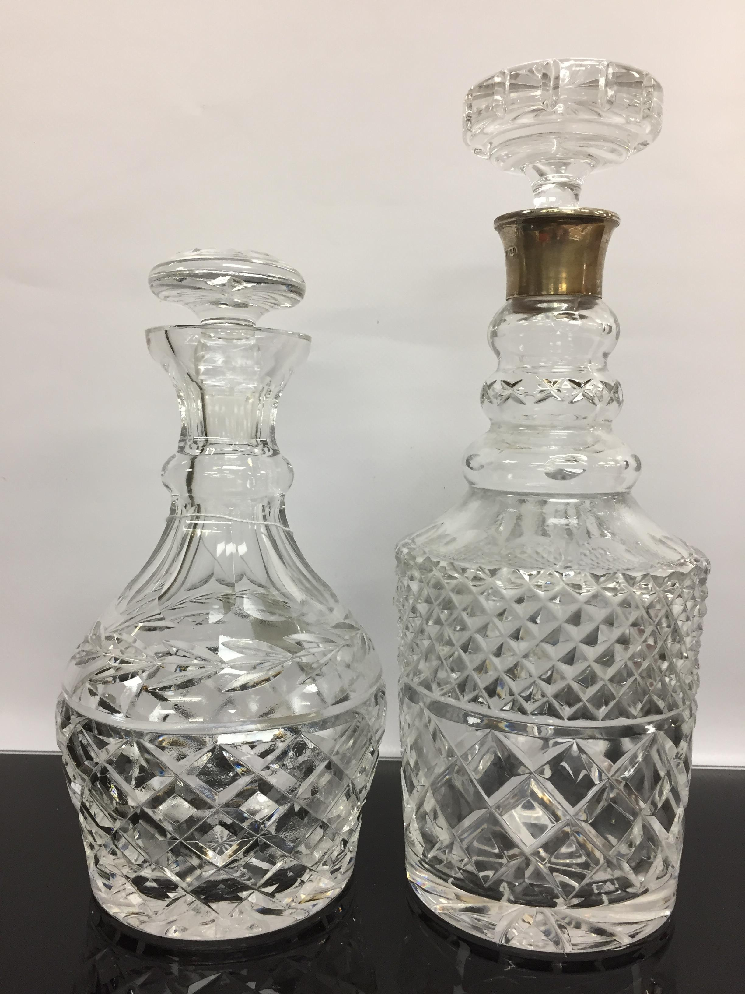 Lot 81 - TWO CUT GLASS LEAD CRYSTAL DECANTERS ONE WITH SILVER COLLAR