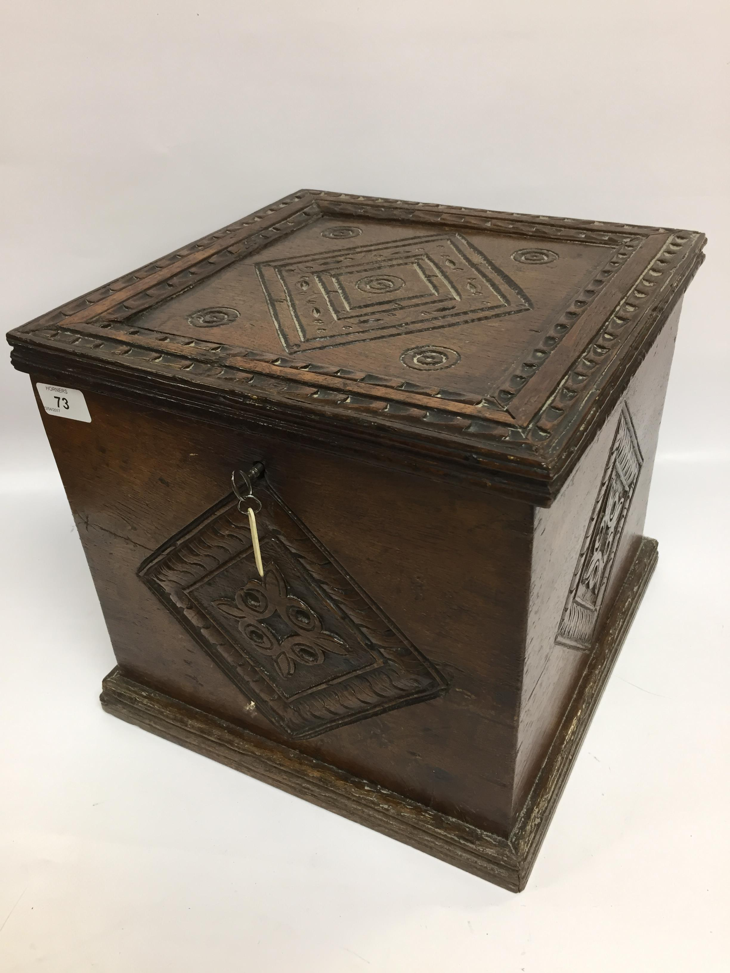 Lot 73 - AN OAK SILVER CABINET WITH CARVED DETAIL