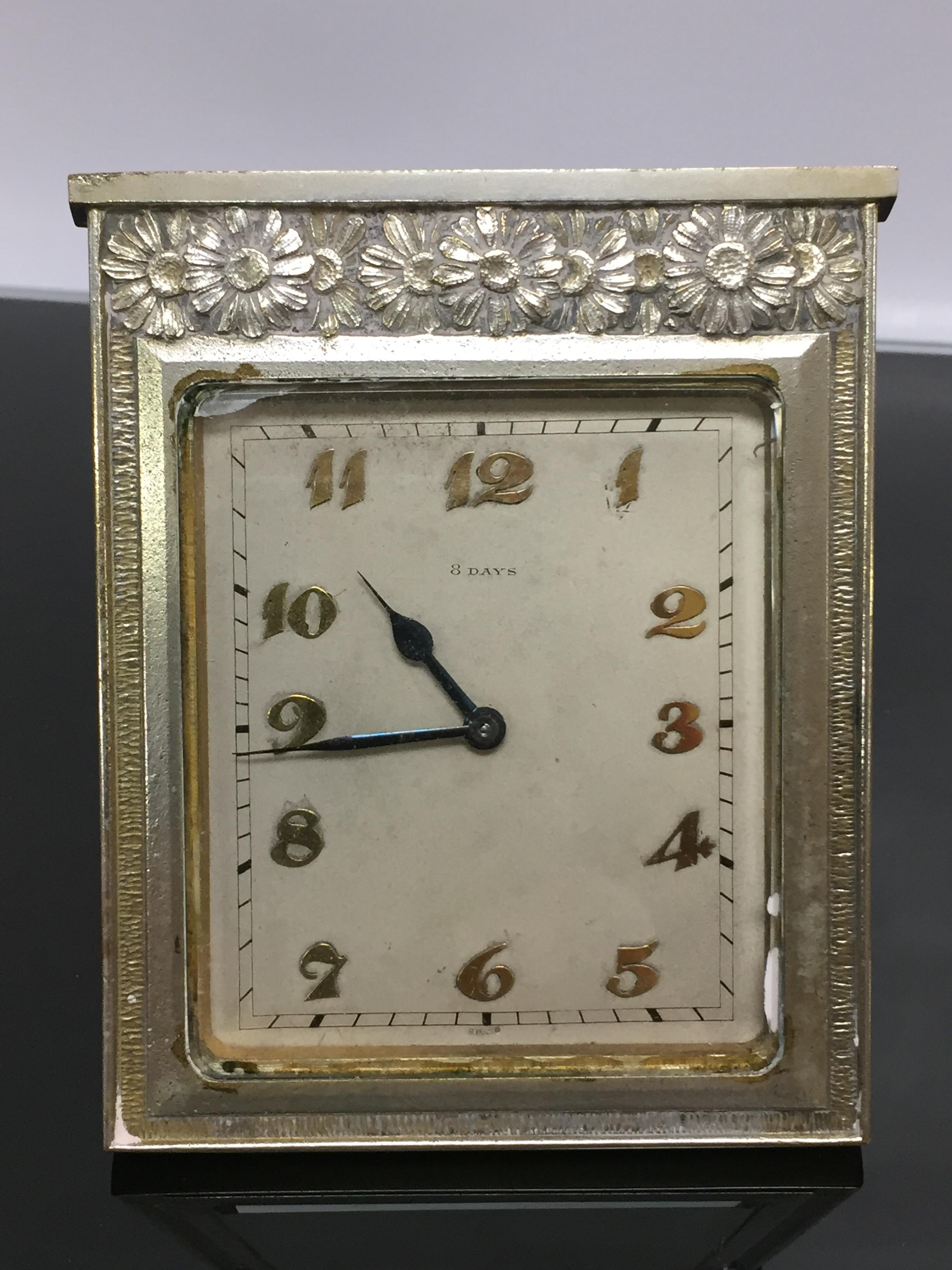 Lot 92 - A SWISS WHITE METAL SQUARE DESK CLOCK IN ART DECO STYLE, FLORAL DECORATION TO TOP BORDER.
