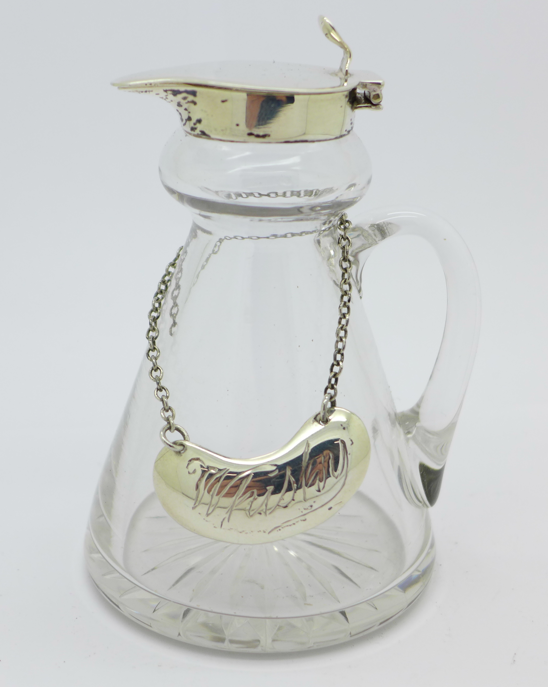 A silver and glass whisky noggin with silver label