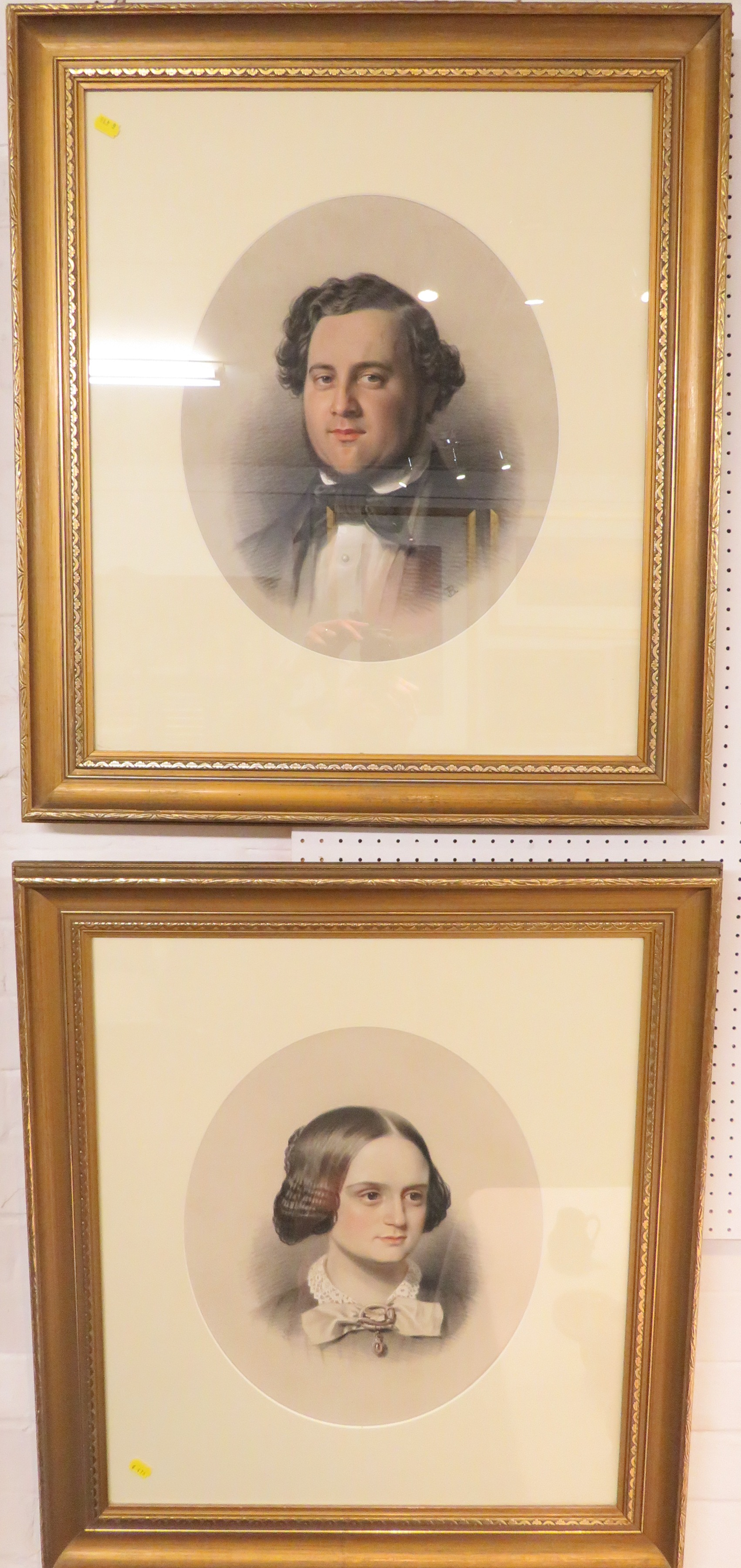 Lot 43 - A pair of pastel and chalk head and shoulder portraits of Victorian gentleman and lady,