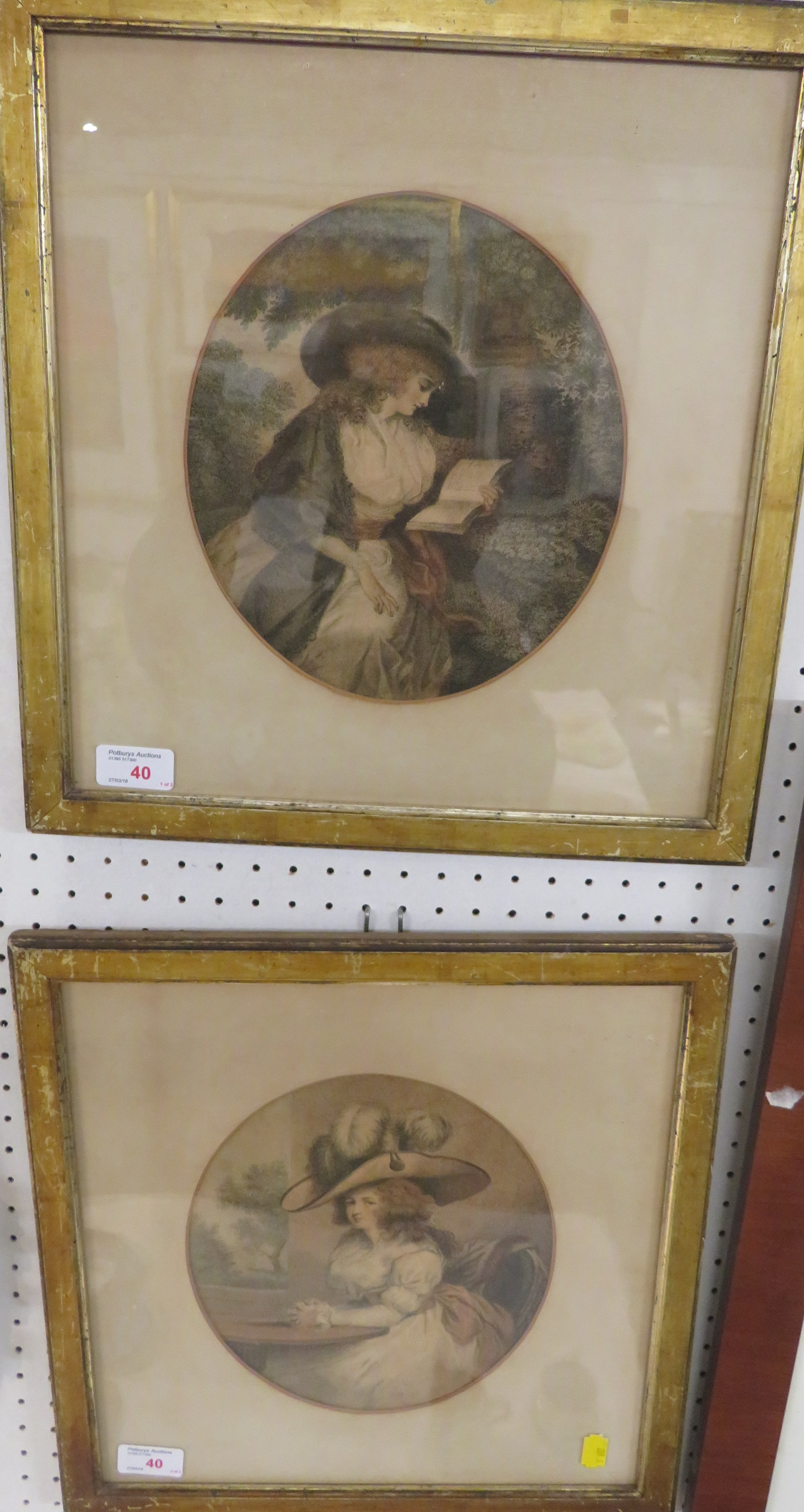 Lot 40 - A pair of tinted stipple engravings, depicting a lady reading and a lady seated at table, in oval