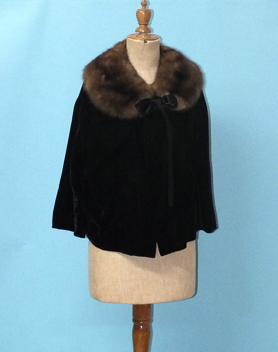 Lot 229 - A Hardy Amies Ready to Wear labelled black velvet evening jacket with musquash collar.