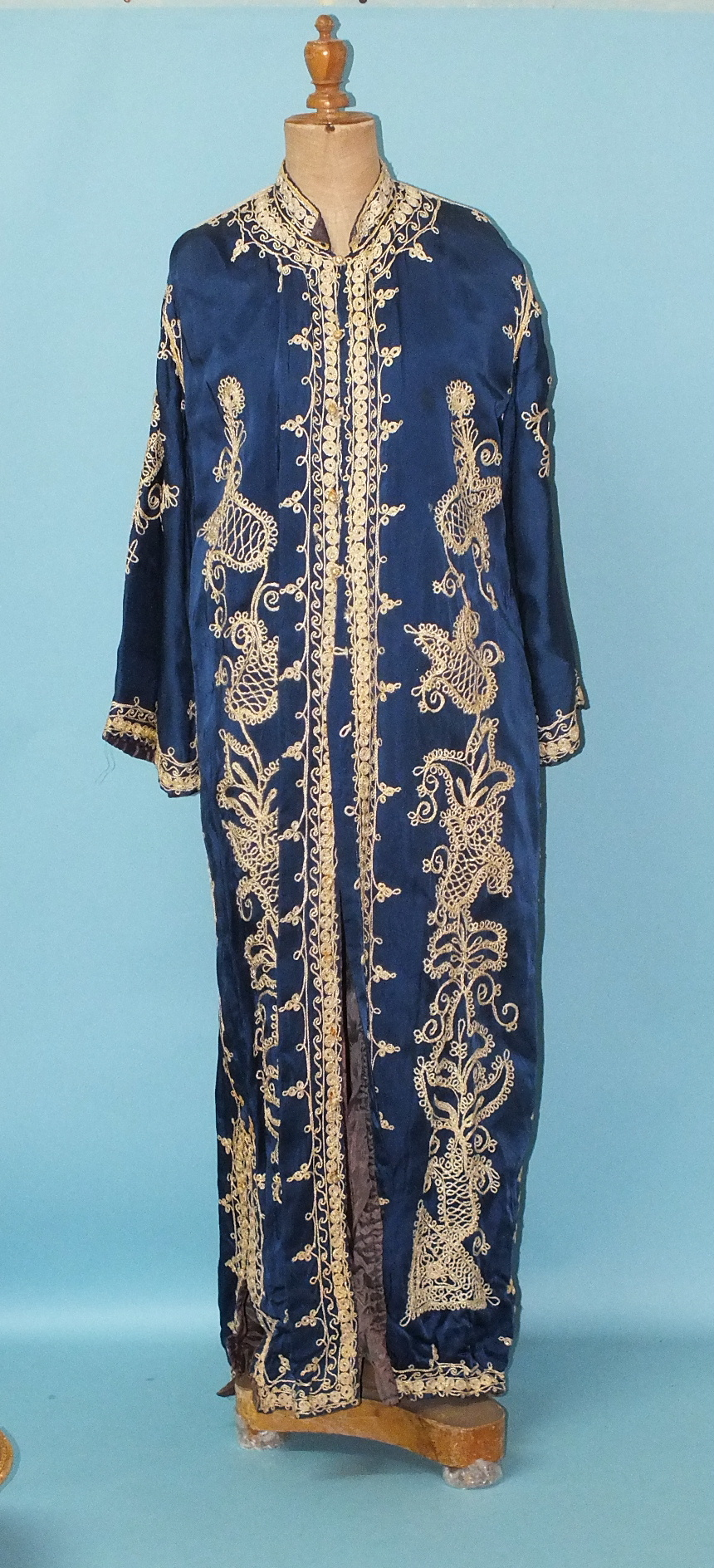 Lot 227 - A deep blue satin coat, possibly Indian, with applied gold thread work, flared sleeves and side