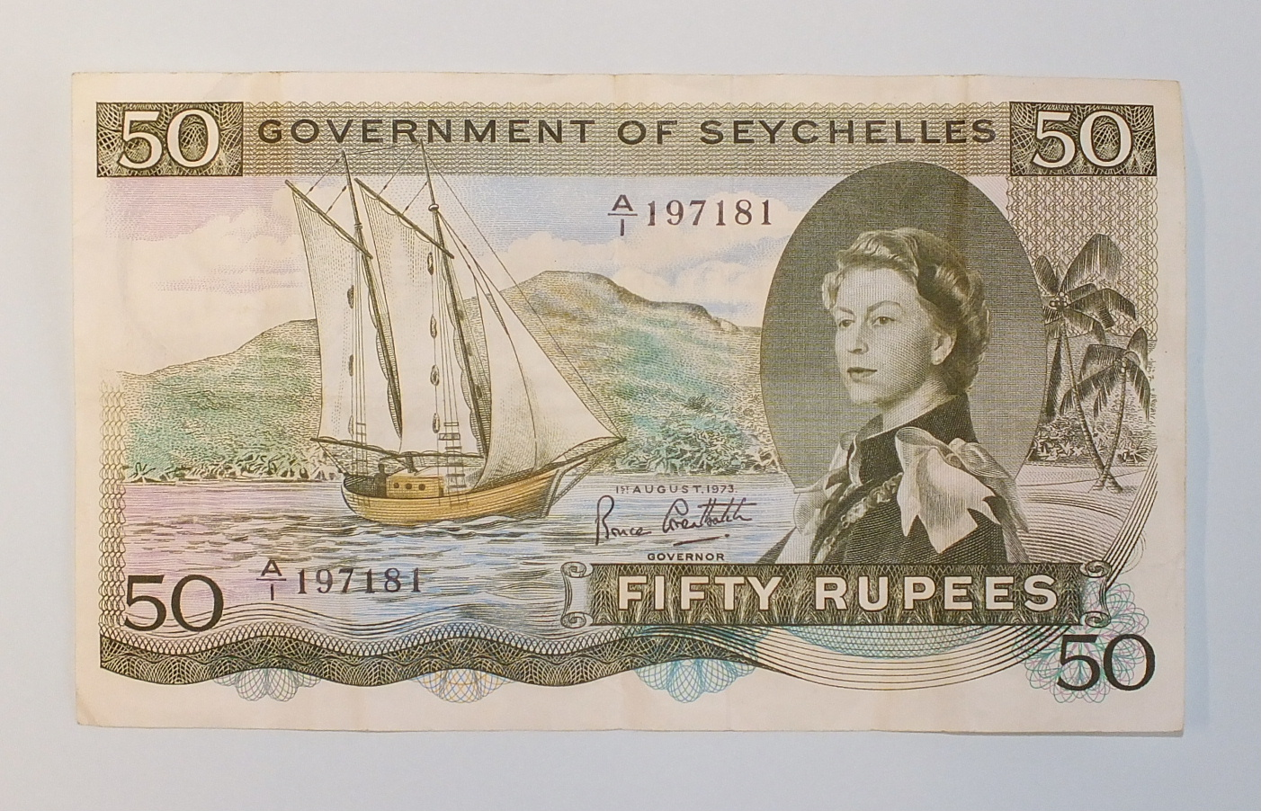 Lot 85 - A Government of Seychelles 50 rupees bank note, A/1 197181, dated 1st August 1973, centre crease.