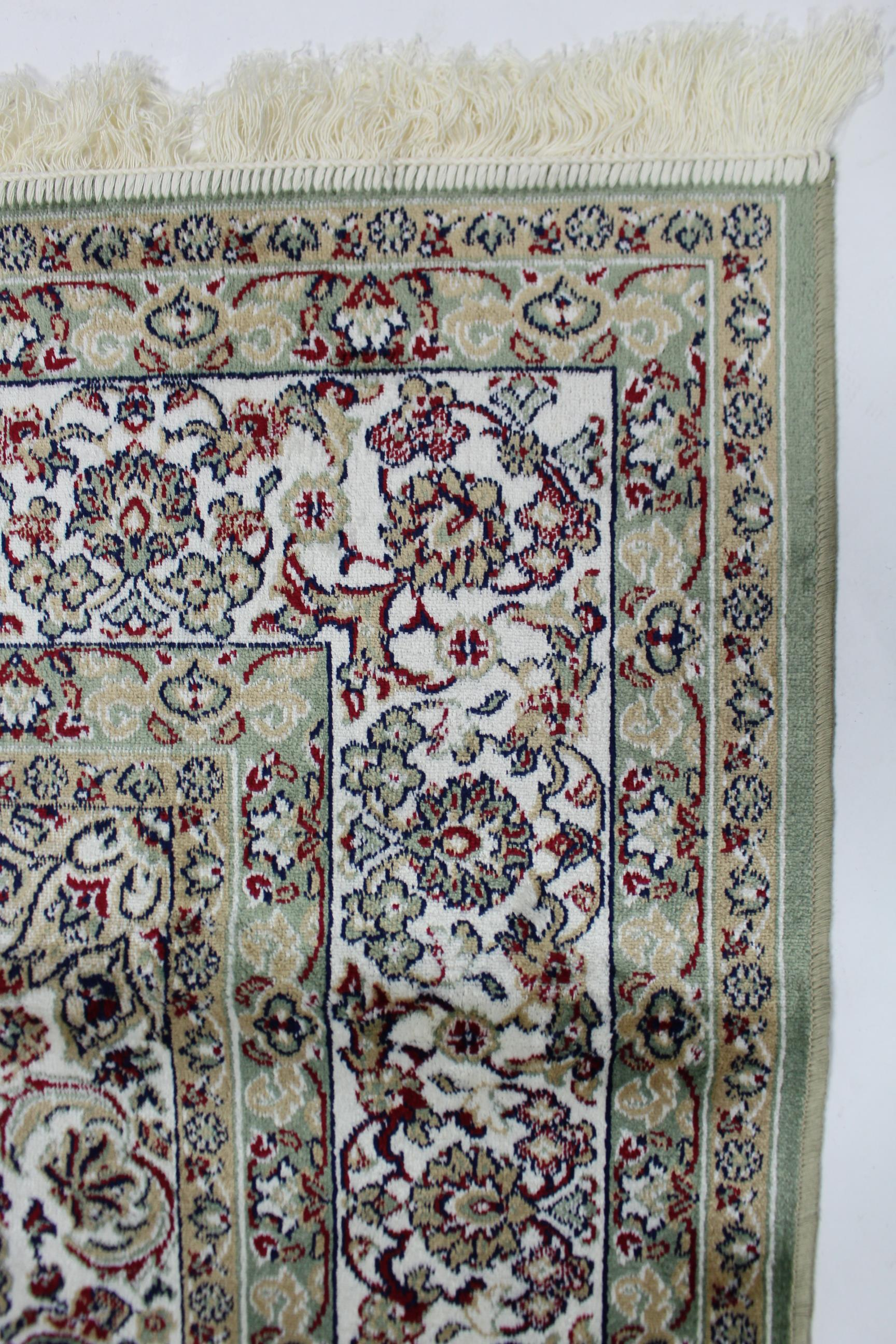 Lot 169 - A Keshan small carpet of pale green ground, & with all-over repeating multi-coloured geometric