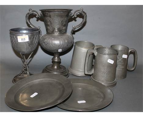 A Victorian pewter rowing trophy, the bowl with open cartouche supported by three oars, 19 cm high (un-engraved), a blue star