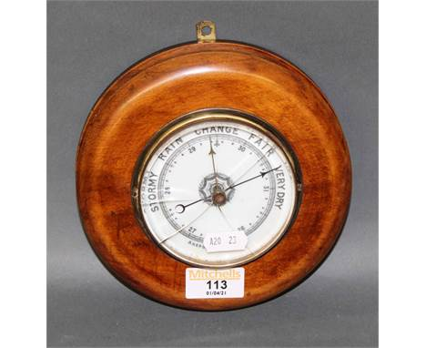 A Victorian stained beech cased aneroid barometer, 16 cm diameter (cracked to glass)