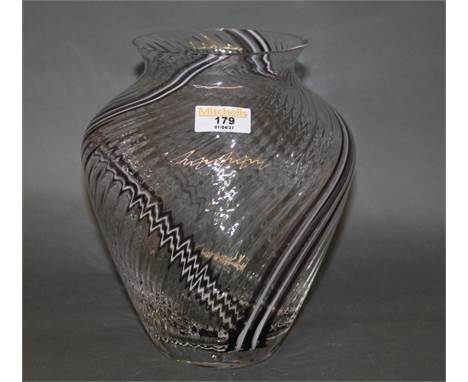 A Caithness clear glass bulbous vase, the spiralled body with white and black streaks, 23 cm high
