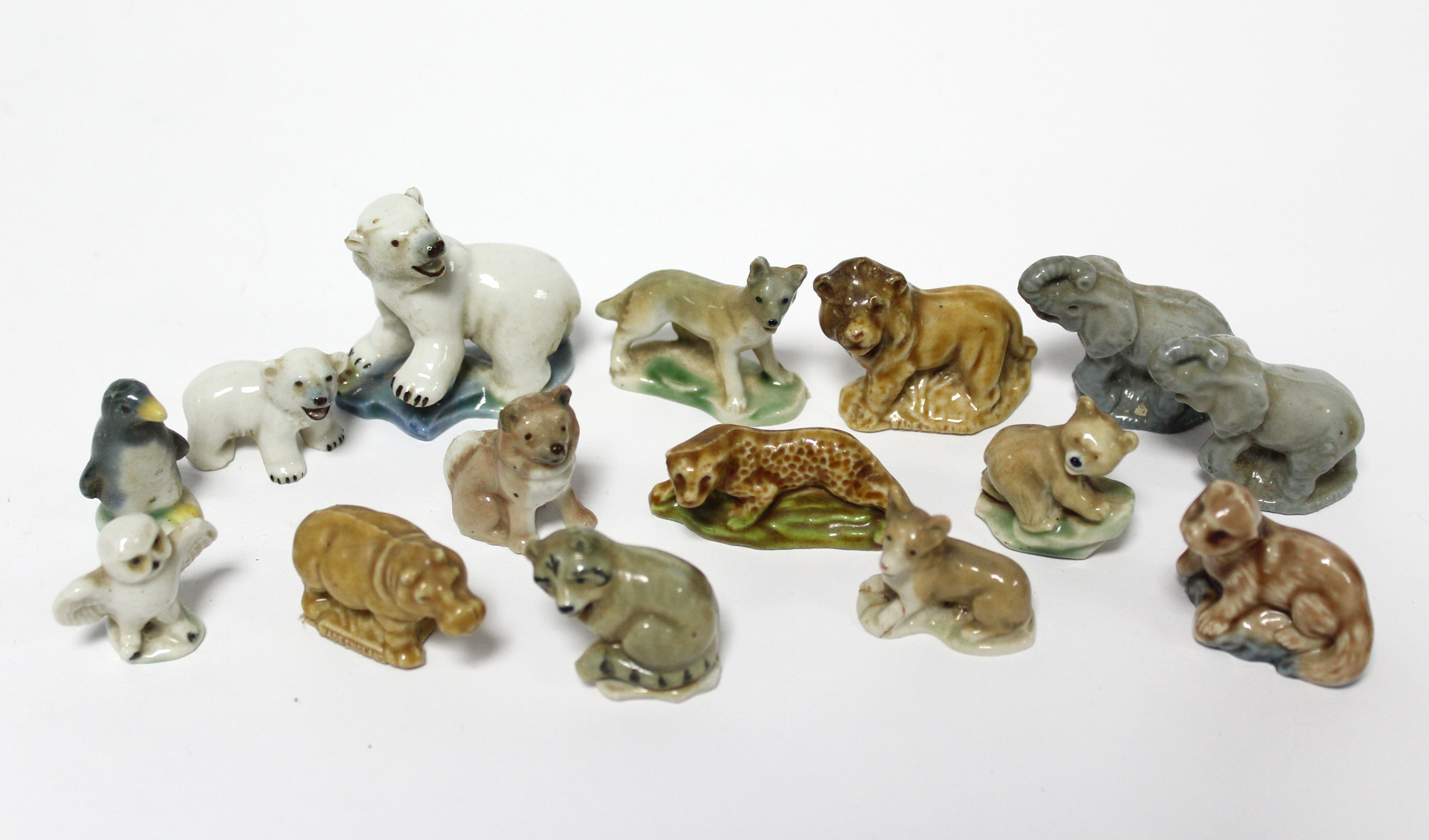 Lot 162 - A Parker fountain pen; two slide rules; & fifteen Wade Whimsies.