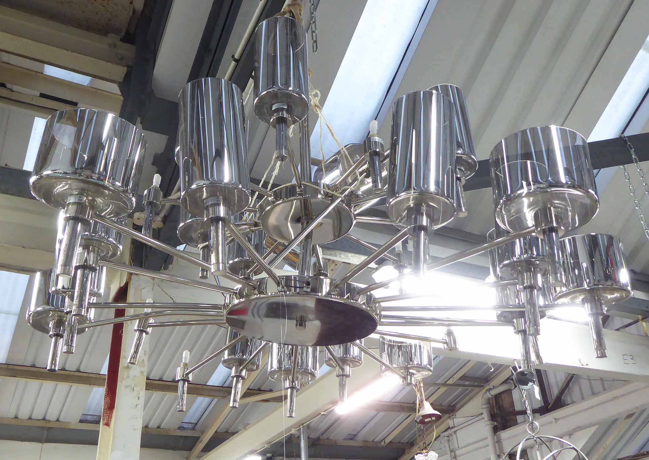 Lot 19 - CHANDELIER, of substantial proportions, with two tiers of cylindrical glass shades, 125cm x 69cm H.
