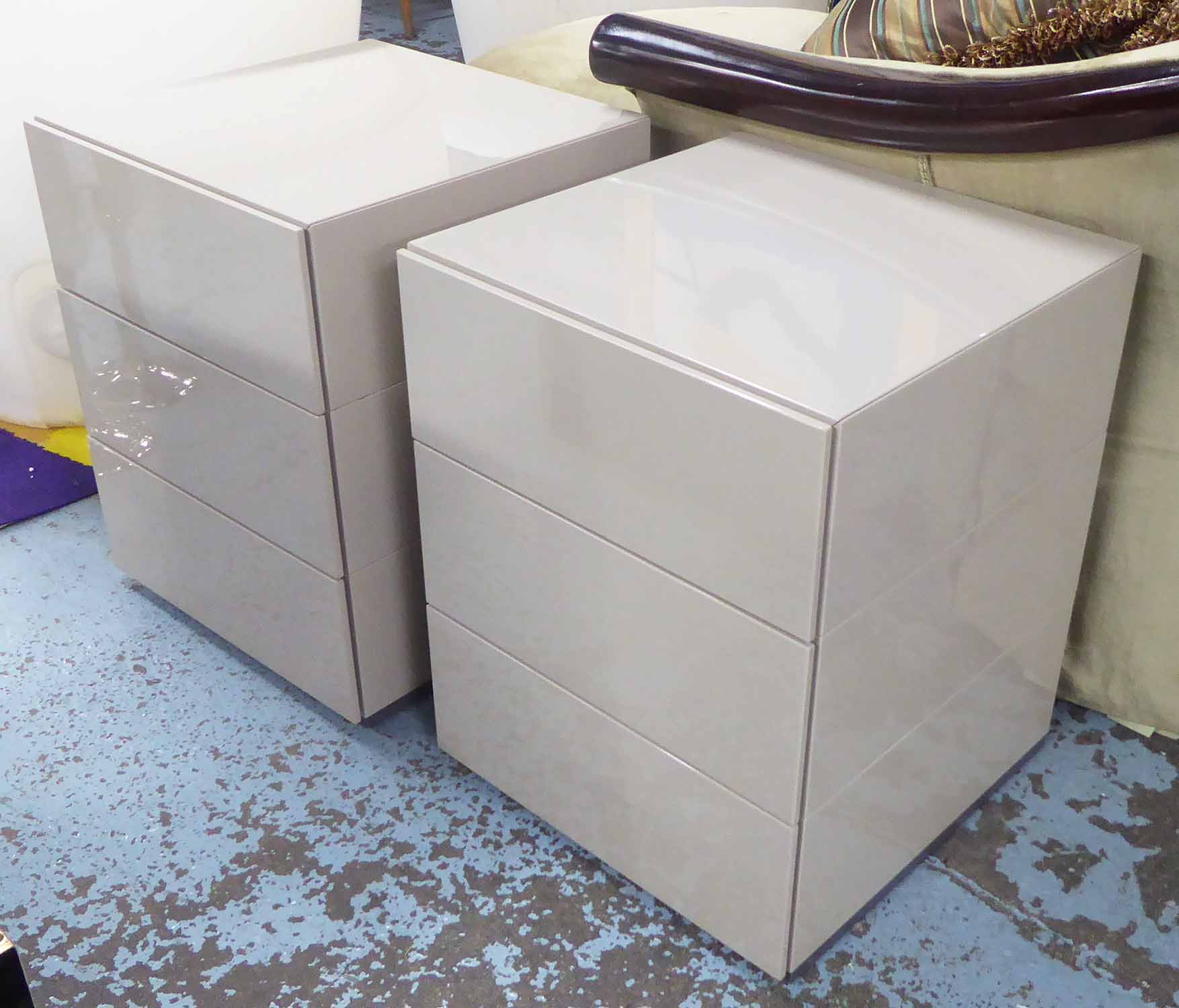 Lot 53 - BENSEN BEDSIDE CHESTS, a pair, each with three drawers, in taupe (cost c.