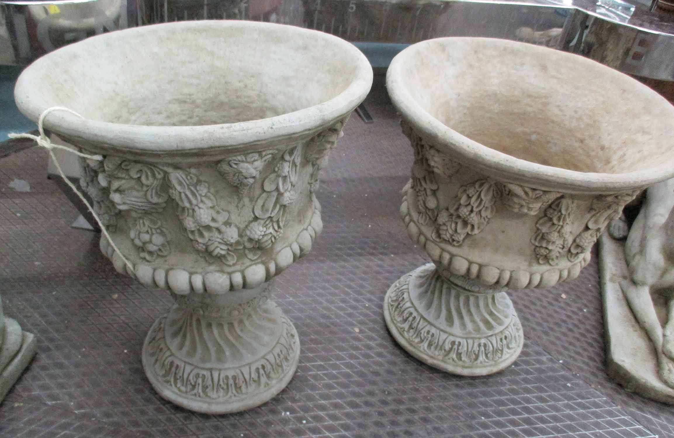 Lot 17 - URNS, a pair, with floral swags, in reconstituted stone, 56cm H.