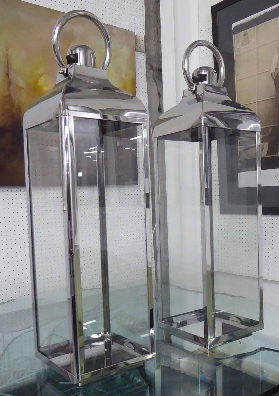 STORM LANTERNS, a pair, polished metal finish, 80cm H.