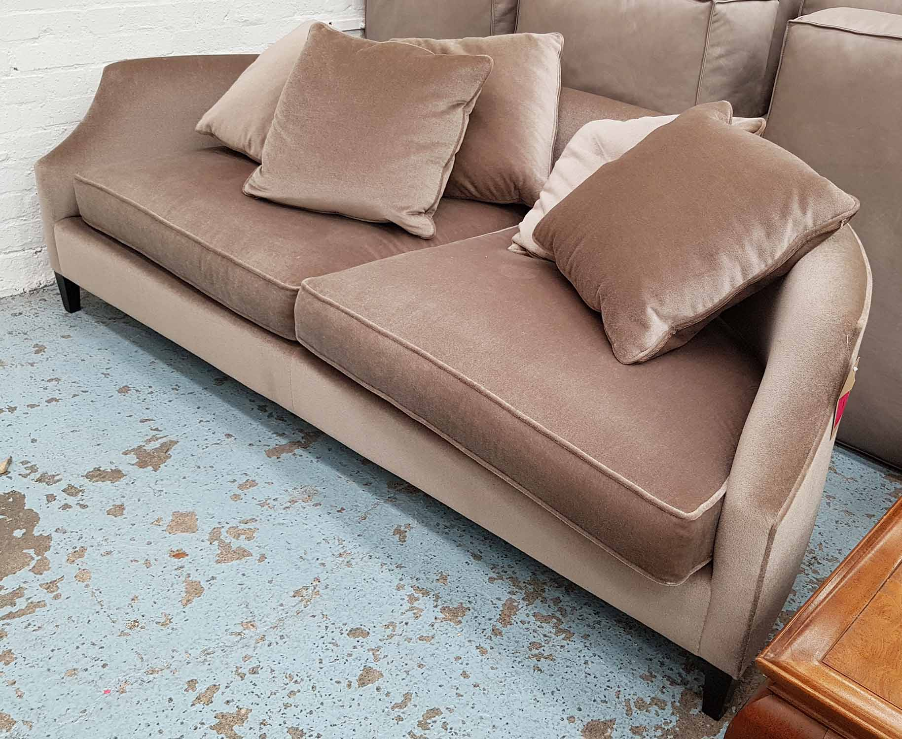 Lot 30 - SOFA, with mushroom coloured chenille upholstery, mid 20th century style, of curved form,