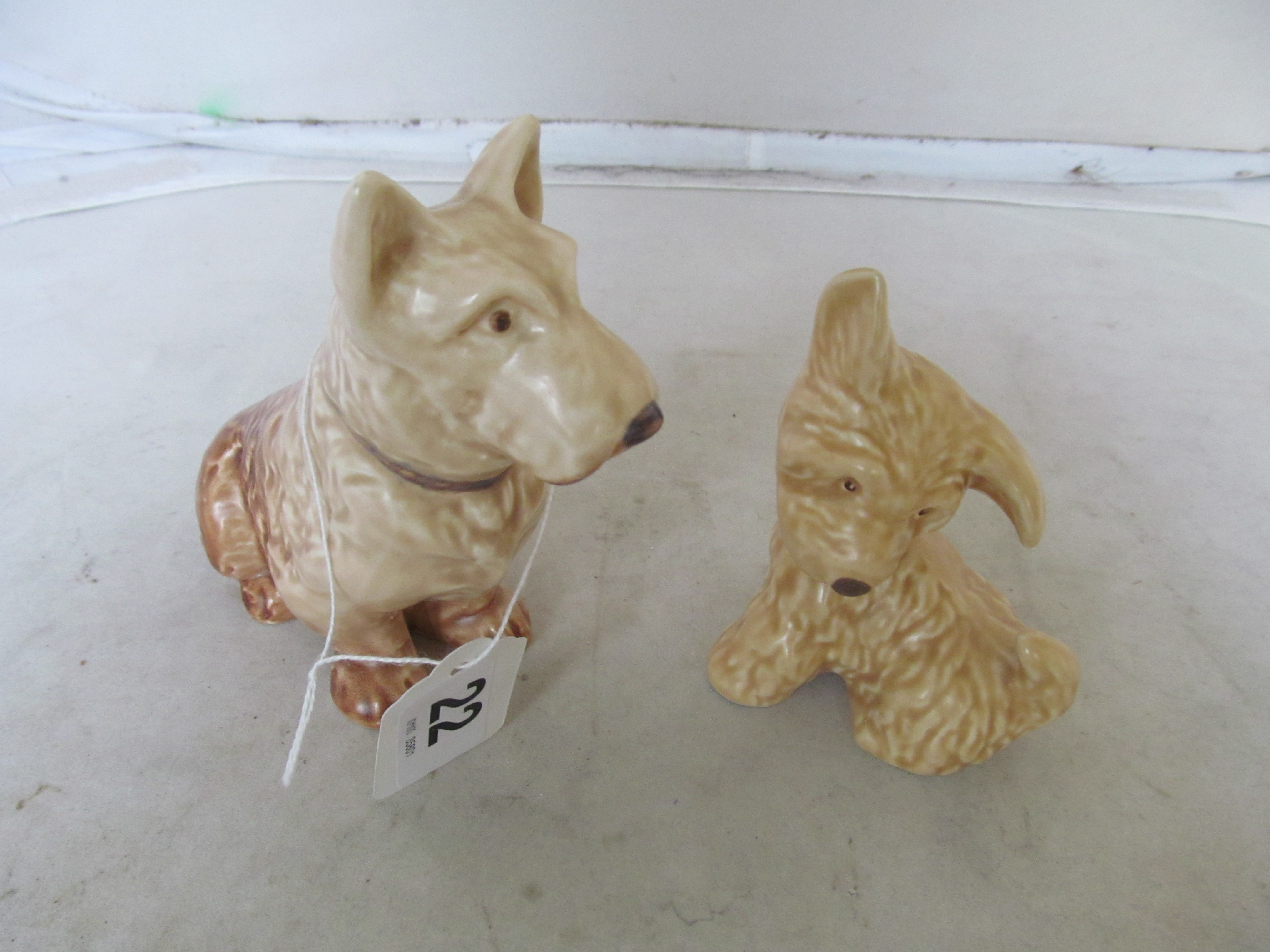 Lot 22 - Two small brown SylvaC dogs
