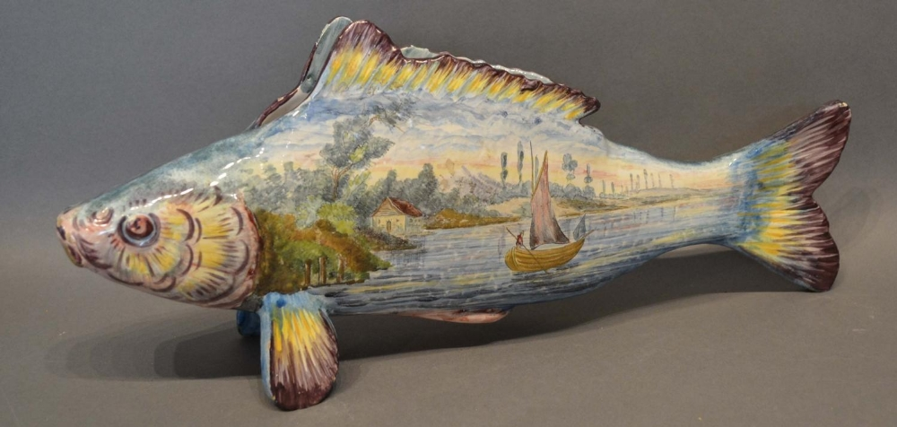 Lot 12 - A Large Faience Vase in the form of a fish, hand painted with boats off a coast, 39cm long