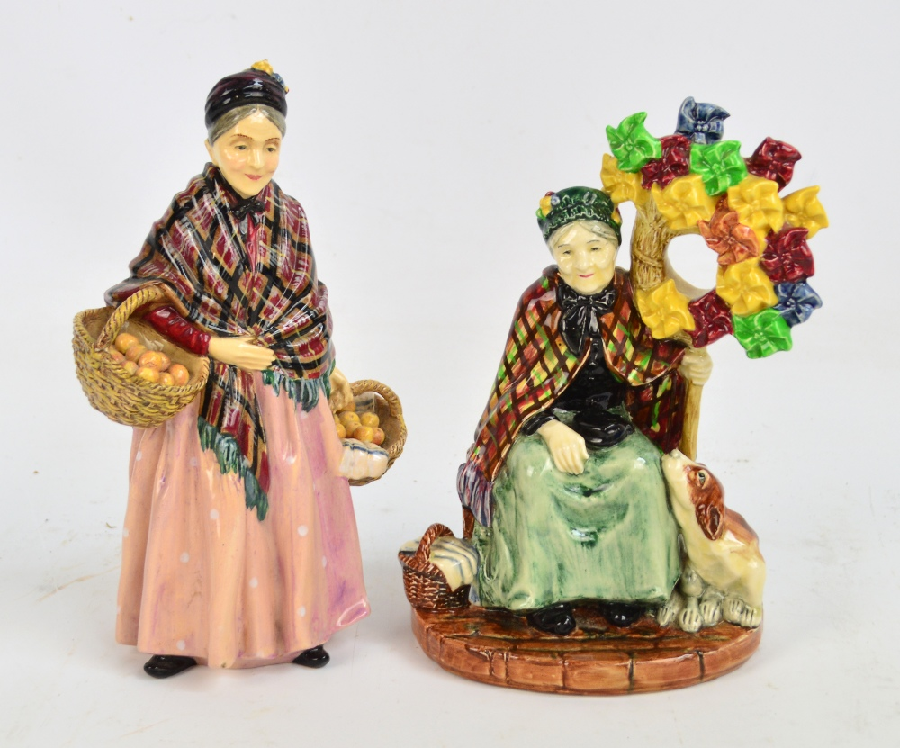 "Lot 452 - Two Royal Doulton figures; HN1400 ""The Windmills Lady"" and HN1759 ""The Orange Lady"" (2)."