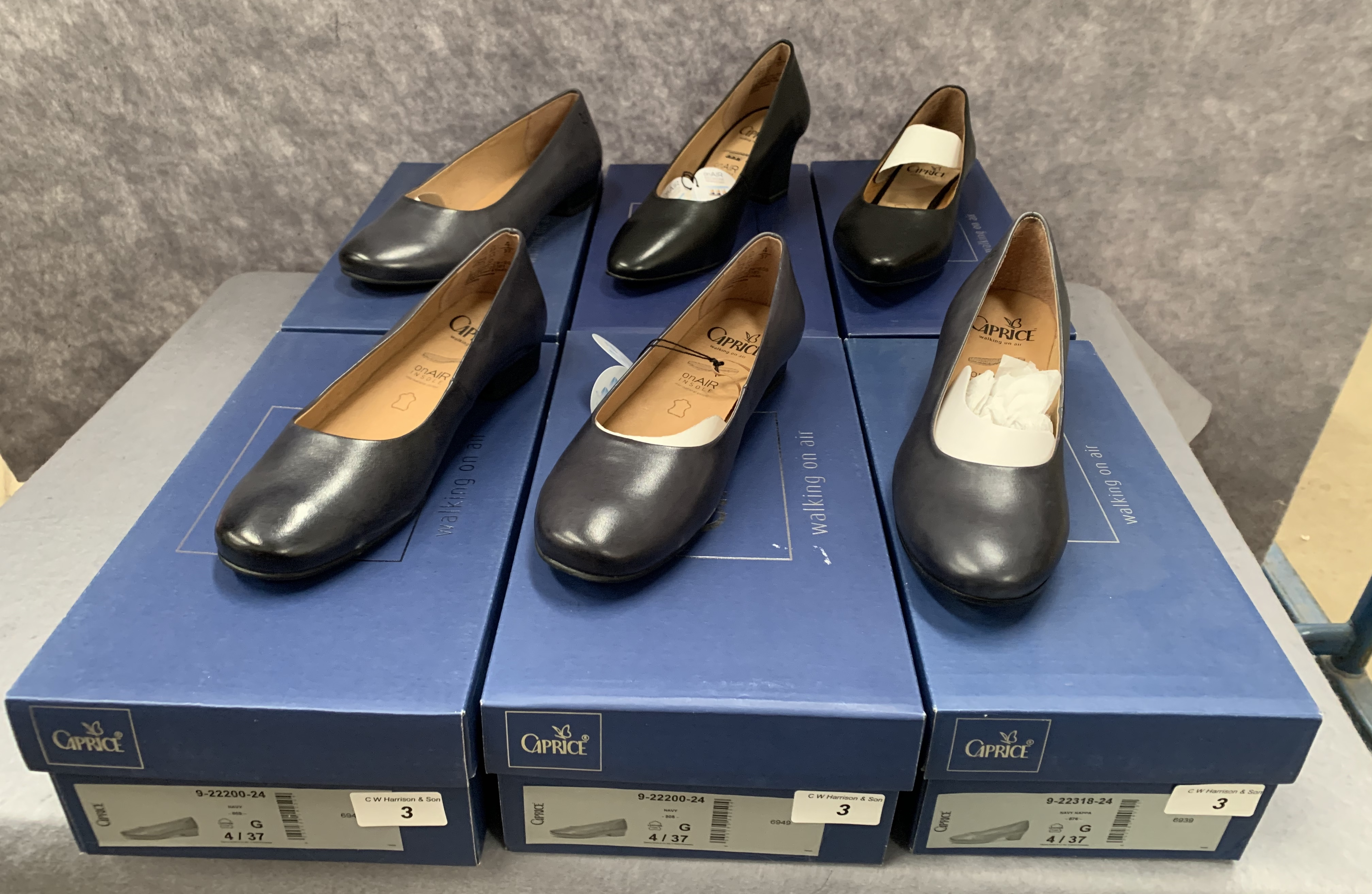 Six pairs of Caprice ladies shoes in black and navy, various styles, size 4, retail price £59.