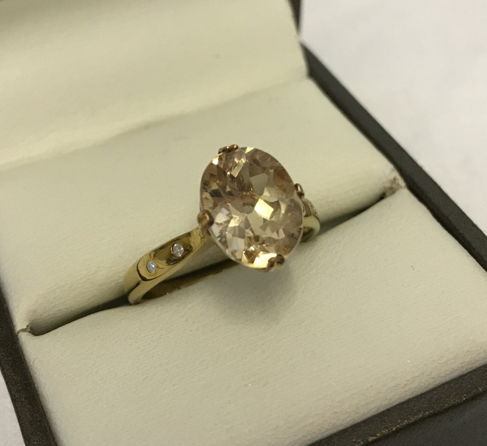Lot 54 - Rocks & Co 9ct gold dress ring set with Imperial Beryl and diamonds.