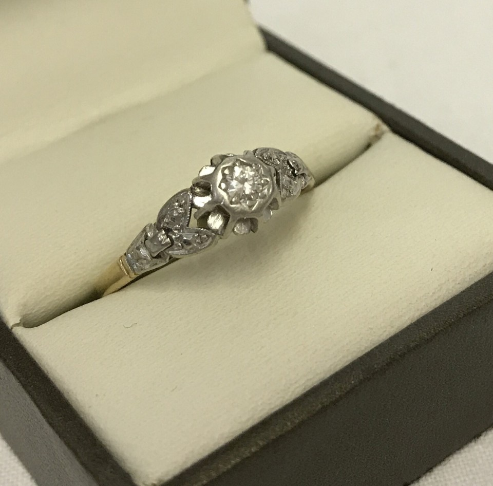 Lot 4 - 18ct gold diamond solitaire with ornate platinum setting.