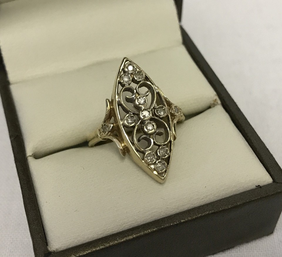 Lot 1 - 9ct gold dress ring of unusual design, set with 13 diamonds in an ornate setting.