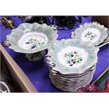 A Real Stone china dessert service with floral decoration and green borders