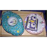 A Quimper ink stand, a nut dish, a floral decorated plate and a lobed dish
