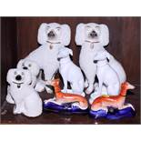 """Two pairs of 19th century Staffordshire dogs, 8"""" x 4 3/4"""" high, a pair of greyhound ink wells, 4"""""""