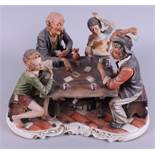 A Capodimonte porcelain group, card players, and another, rearing horses