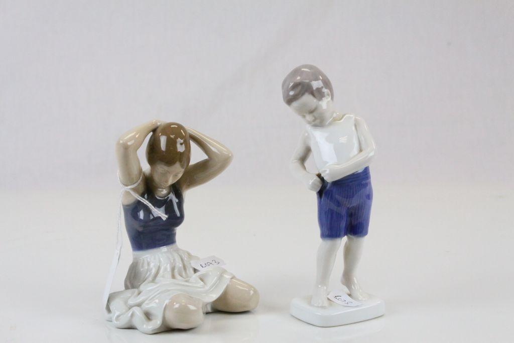 Lot 12 - Two Royal Copenhagen ceramic figurines, one marked B & G 1759, the other UX 4648 to bases