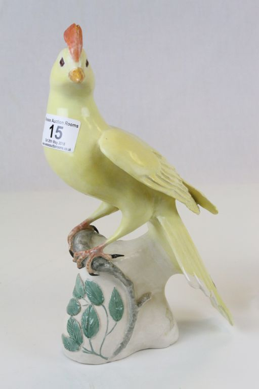 Lot 15 - Pair of 19th Century hand painted ceramic models of Yellow birds, one marked G 19'76, the other G