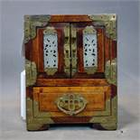 A small Chinese jewel box chest with decorative brass fittings, lock and jade insets, 178mm high x