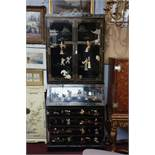 A Chinese style lacquered bureau bookcase, with allover figural decoration. H.225 W.93 D.50cm
