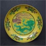 A yellow ground dish representing a Dragon and a Phoenix together with a collection of small