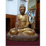A large Burmese gilt wood seated Buddha, with coloured glass detailing, H.112 W.90cm