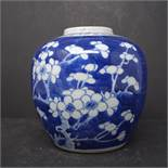 A Chinese ginger jar, with no lid, with prunus decoration, bearing double blue circle to base, H.