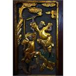A Chinese carved wood panel, gold lacquer with some colour, of two fighting warriors, 230mm x