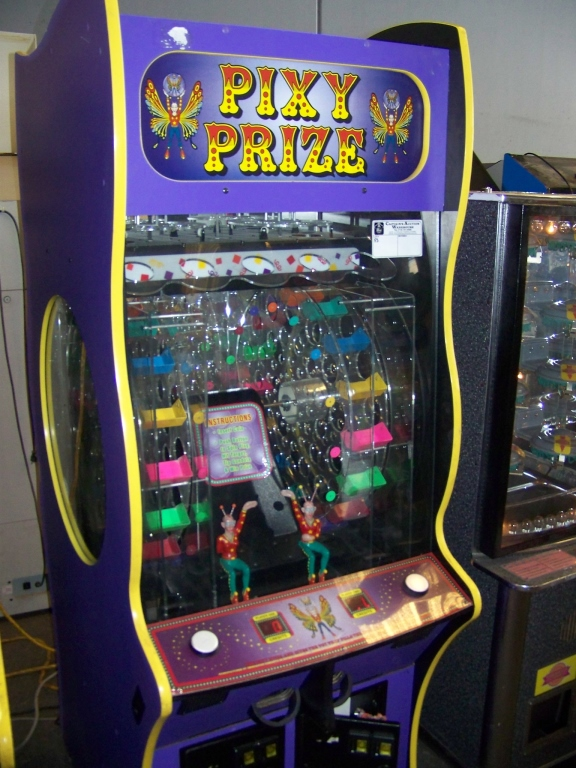 Lot 50 - PIXY PRIZE CAPSULE PRIZE VENDING MACHINE ICE Item is in used condition. Evidence of wear and