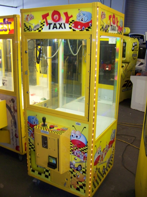 """Lot 38 - 30"""""""" TOY TAXI PLUSH CLAW CRANE MACHINE Item is in used condition. Evidence of wear and commercial"""