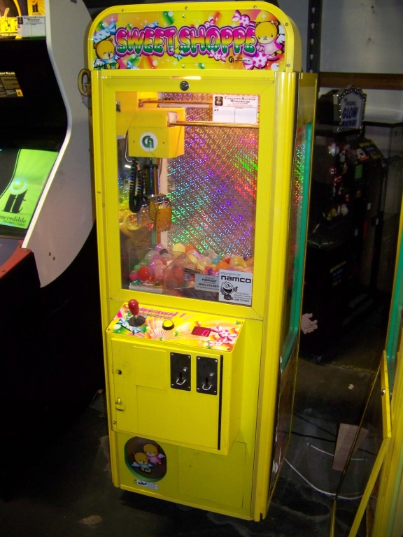 "Lot 39 - 24"""" CANDY SHOPPE CRANE MACHINE COASTAL Item is in used condition. Evidence of wear and commercial"