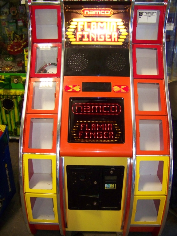 Lot 23 - FLAMIN FINGER PRIZE REDEMPTION GAME N Item is in used condition. Evidence of wear and commercial