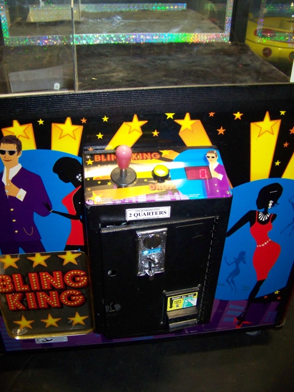 "Lot 25 - 42"""" BLING KING JEWELRY CLAW CRANE MACHINE COASTAL Item is in used condition. Evidence of wear and"