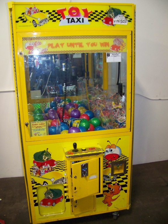 """Lot 29 - 42"""""""" TOY TAXI DUAL CLAW WINNER EVERY PLUSH CRANE Item is in used condition. Evidence of wear and"""