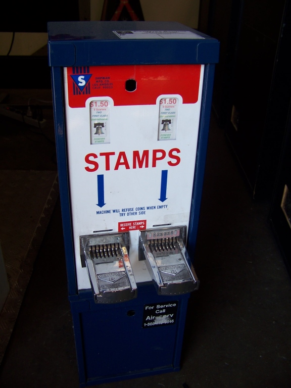 Lot 16 - STAMP VENDING MACHINE U.S. POSTAGE Item is in used condition. Evidence of wear and commercial