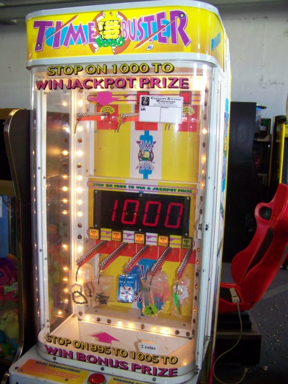 Lot 44 - TIME BUSTERS PRIZE REDEMPTION GAME LAI GAMES Item is in used condition. Evidence of wear and